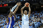22 December 2012: North Carolina's Brice Johnson (11) shoots over McNeese State's Desharick Guidry (left). The University of North Carolina Tar Heels played the McNeese State University Cowboys at the Dean E. Smith Center in Chapel Hill, North Carolina in an NCAA Division I Men's college basketball game. UNC won the game 97-63.