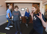 NWA Democrat-Gazette/FLIP PUTTHOFF <br /> Coach Gabriele Campbell (right) get boxers John Brown (from left), Judy Wamsher and Sheryl Morelan moving Dec. 5 2018 during a workout.