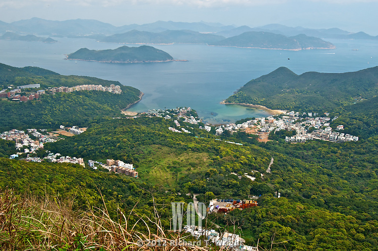The seaside village of Tai Hang Hau and Port Shelter as seen from the top of Junk Peak, a popular hiking trail in Hong Kong