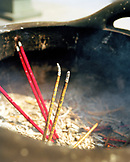 CHINA, Putou Shan, insense burns in temple on the island of Putou Shan