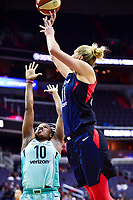 Washington, DC - June 15, 2018: Washington Mystics guard Elena Delle Donne (11) shots a jump shot over New York Liberty guard Epiphanny Prince (10)  during game between the Washington Mystics and New York Liberty at the Capital One Arena in Washington, DC. (Photo by Phil Peters/Media Images International)