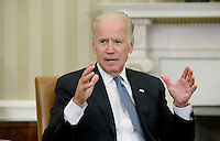 United States Vice President Joe Biden discusses the release of the Cancer Moonshot Report in the Oval Office of the White House on October 17, 2016 in Washington, DC. <br /> Credit: Olivier Douliery / Pool via CNP /MediaPunch