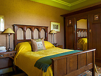 The bed and the wardrobe in this bedroom are both from the Arts & Crafts period