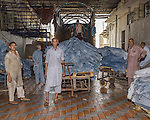 Fresh 'wet blue' leather arrives at the unloading docks. Most of the process of 'wet blue' leather takes place in various facilities in the Punjab, though some smaller local tanneries do produce the material in Karachi. 'Wet blue' is the name given to the raw, unprocessed but prepared animal skins where chromium sulfate and other chromium salts are used. It is more supple and pliable than vegetable-tanned leather and does not discolor or lose shape as drastically in water as vegetable-tanned. It is also known as wet-blue for its color derived from the chromium. More exotic colors are possible when using chrome tanning. The chrome tanning method usually only takes a day to finish, and the ease and agility of this method make it a popular choice. It is reported that chrome-tanned leather adds up to 80% of the global leather supply.