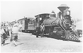 Rio Grande's old T-12s #168 has become &quot;Old Montezuma, No. 1&quot; for the movie, &quot;The Texas Rangers&quot;.  It's at the Espanola depot with a Chili Line train of the mid-1930s and has drawn a big crowd to see it.  The conductor and engineer are posing for the camera.<br /> D&amp;RGW  Espanola, NM  1935