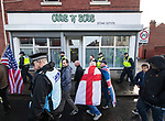 © Joel Goodman - 07973 332324 . 20/01/2018. Doncaster, UK. Far-right street protest movement , the English Defence League ( EDL ) march through Hexthorpe after holding a demonstration , opposed by anti-fascists , including Unite Against Fascism ( UAF ) in the Hexthorpe area of Doncaster . EDL supporters chanted anti-Roma slogans as they marched through the town . Photo credit : Joel Goodman