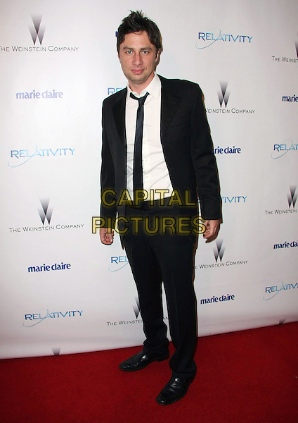 ZACH BRAFF .Relativity Weinstein Company 68th Annual Golden Globe Awards After Party Presented by Marie Claire held at the Beverly Hilton, Beverly Hills, California, USA..January 16th, 2011.full length black suit tie white shirt .CAP/ADM/TB.©Tommaso Boddi/AdMedia/Capital Pictures.
