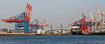 Hamburg-Germany - May 04, 2013 -- Port of Hamburg / harbour at the river Elbe: container cranes at CTB Container Terminal Burchardkai (left) and EUROGATE (right)(both HHLA, Hamburger Hafen und Logistik Aktiengesellschaft), with the Köhlbrandbrücke (bridge over Koehlbrand) Infrastructure -- Photo: © HorstWagner.eu