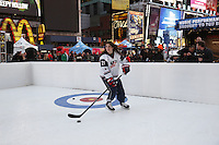 NEW YORK - OCT 29: USA Hockey player Hilary Knight picks up speed on the demo rink. Olympic athletes participate in 100 Days to Sochi, a promotional event for the US Olympic Team, on Tuesday, October 29, 2013 in New York City. (Photo by Landon Nordeman)
