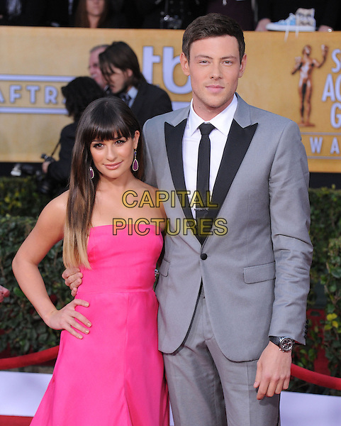 Lea Michele (wearing Valentino) & Corey Monteith.Arrivals at the 19th Annual Screen Actors Guild Awards at the Shrine Auditorium in Los Angeles, California, USA..27th January 2013.SAG SAGs half length pink strapless dress hand on hip grey gray suit black lapels tie white shirt dip dye hair .CAP/DVS.©DVS/Capital Pictures.