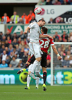 Pictured: Gylfi Sigurdsson of Swansea heads the ball over Morgan Schneiderlin of Manchester United Sunday 30 August 2015<br /> Re: Premier League, Swansea v Manchester United at the Liberty Stadium, Swansea, UK