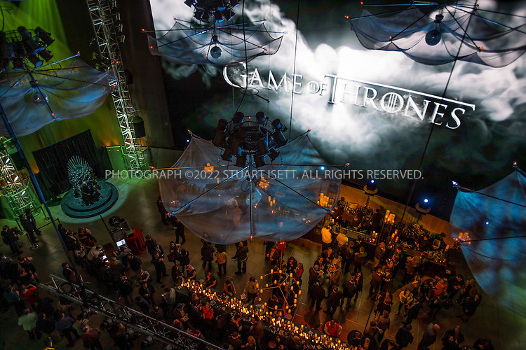 3/21/2013--Seattle, WA, USA..Fans get to sit in the throne (left) at an after party at the Experience Music Project (EMP). HBO's Game of Thrones season 3 premiered at Seattle's Cinerama cinema earlier that evening..©2013 Stuart isett. All rights reserved.