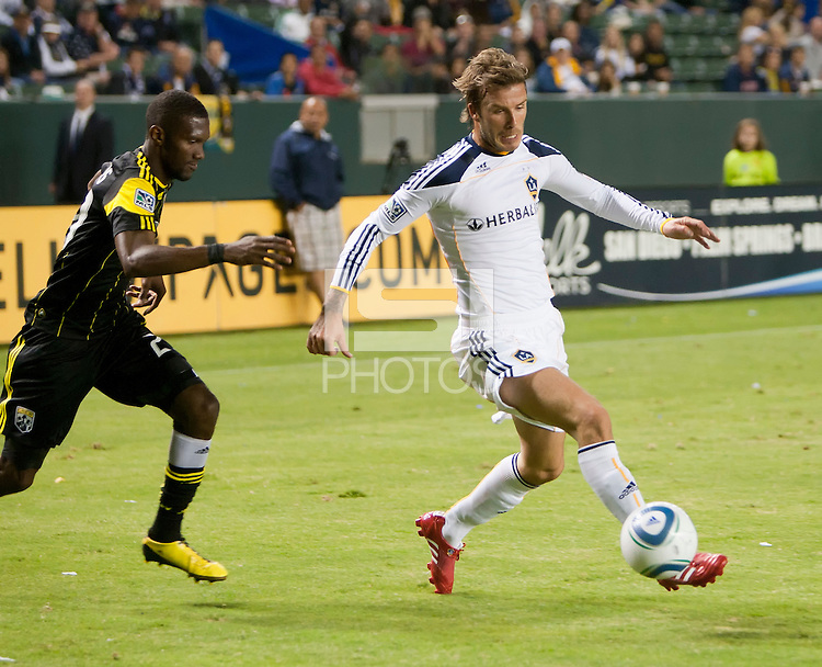 Galaxy midfielder David Beckham (23) works the ball past Crew defender Shaun Francis (29) during the second half of the game between LA Galaxy and the Columbus Crew at the Home Depot Center in Carson, CA, on September 11, 2010. LA Galaxy 3, Columbus Crew 1.