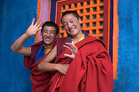 Tibetan Buddhist Monks wave at the Cham dances at the Katok Dorjeden Monastery - Kham, (eastern, Tibet), Sichuan, China