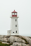 The lighthouse at Peggy's Cove, Nova Scotia, with fog over the Atlantic ocean