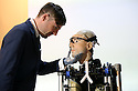 "World's first bionic man at Science museum today.5.2.13.Bertold Meyer - who has a bionic hand himself - with the robot ""Rex"".as TV crews look on.Face of Rex was modelled on Bertold....Pic by Gavin Rodgers/Pixel 8000 Ltd"