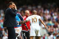 Francesco Guidolin manager of Swansea instructs Andre Ayew of Swansea after his goal while Slaven Bilic manager of West Ham United looks defeated   during the Barclays Premier League match between West Ham United and Swansea City  played at Boleyn Ground , London on 7th May 2016