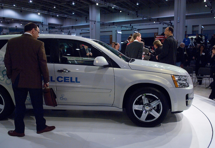 WASHINGTON, DC - Jan. 22: A member of the media looks over a Chevy Equinox Fuel Cell vehicle during media day at the Washington Auto Show. (Photo by Scott J. Ferrell/Congressional Quarterly)