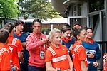 Roland Garros. Paris, France. June 1st 2012.A day with the ball boys..A coach help a Gaelle with her hair