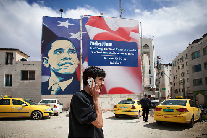 March 2013, Ramallah, Palestinian Territories. As the U.S. president Barack Obama is expected for official visit in Ramallah, posters have been displayed to catch the president's attention about the non access to the 3G, due to a restriction that Israel imposes on the waves control for Palestinian telecommunication companies. The reactions to this signs were multiple in the West Bank:  Critics against the poster were made, arguing that the 3G network was the least of Palestinian's problem, and that real human right violation should be emphasized. Most of the posters were vandalized. In the first ground, Jihad, 22, is the parking guard. Born orphan, he struggles to live with 30 shekel a day (6 euro).