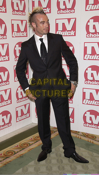 FRAN COSGRAVE.At the TV Quick & TV Choice Awards,.Dorchester Hotel, Park Lane,.London, 5th September 2005.full length black suit mohawk hair.www.capitalpictures.com.sales@capitalpictures.com.© Capital Pictures.