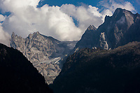 Switzerland. Canton Graubunden. Bregaglia valley. View from Soglio on the mountains above  Bondo. The village was hit by two massive landslides caused by a giant rockslide swept down from Piz Cengalo on August 23, 2017. Right to left: The mountains' names are Piz Badile (3308 m), Piz Cengalo (3369m), Piz dei Gemelli (3259), Sciora Dadent (or Sciora di Dentro) (3,275 m). 26.08.2017 © 2017 Didier Ruef