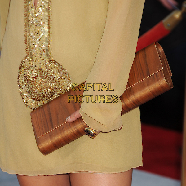 "Vanessa Hudgens' bag.Premiere of ""Captain America: The First Avenger"" held at The El Capitan Theatre in Hollywood, California, USA..July 19th, 2011.detail ring beads beaded yellow gold dress sequins sequined brown clutch bag wood wooden print  .CAP/ADM/BP.©Byron Purvis/AdMedia/Capital Pictures."