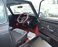 BNPS.co.uk (01202 558833)<br /> Pic: Brightwells/BNPS<br /> <br /> The Mini boasts a deluxe '30th Anniversary' interior.<br /> <br /> Minted - 1989 Mini that's only covered a handful of miles in 31 years has more than trebled in value.The 'time capsule' Mini has covered just 12 miles in its long life and is being sold in virtually brand new condition for £20,000. The 1989 Mini 30 was a special version made to mark the classic British motor's 30th anniversary. Its three owners have all kept in storage and as a result the unused car is in the same pristine condition as when it left the Austin factory in Longbridge, Warwicks, in 1989.It is being sold by auctioneers Brightwells for four times its original asking price.
