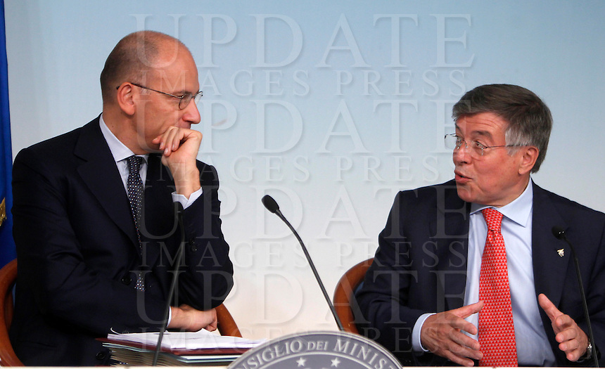 Il Presidente del Consiglio Enrico Letta ed il Ministro dello Sviluppo Economico Flavio Zanonato, a destra, durante la conferenza stampa al termine del Consiglio dei Ministri a Palazzo Chigi, Roma, 19 settembre 2013.<br /> Italian Premier Enrico Letta and Economic Development Minister Flavio Zanonato, right, during a press conference at the end of a cabinet meeting at Chigi Palace, Rome 19 September 2013.<br /> UPDATE IMAGES PRESS/Isabella Bonotto