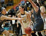 RAPID CITY, SD: DECEMBER 1:  Abby Switzer #20 of Black Hills State dribbles between South Dakota Mines defenders during their Rocky Mountain Athletic Conference women's basketball game Saturday evening at the King Center Rapid City, S.D.  (Photo by Richard Carlson/dakotapress.org)