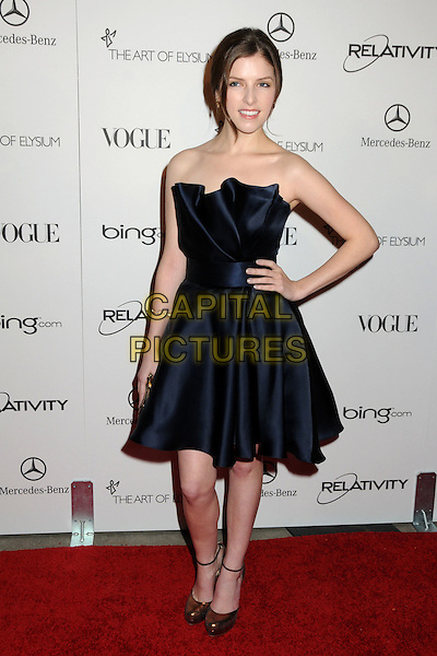 "ANNA KENDRICK .attends the Art of Elysium 4th Annual Charity Gala ""Heaven"" held at The Annenberg Building at The California Science Center in Los Angeles, California, USA, January 15th 2011..full length strapless navy blue silk satin dress hand on hip mary janes shoes  .CAP/ADM/BP.©Byron Purvis/AdMedia/Capital Pictures."