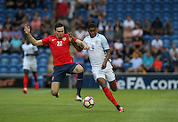Ole Selnaes of Norway dives in on Marcus Rashford (Manchester United) of England during the International EURO U21 QUALIFYING - GROUP 9 match between England U21 and Norway U21 at the Weston Homes Community Stadium, Colchester, England on 6 September 2016. Photo by Andy Rowland / PRiME Media Images.