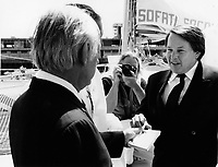 Montreal (QC) CANADA  JUne 7 1984 file photo -<br /> Rene Levesque (L) offer a cigarette to Bernard Landry (R) while they attend the baptism of SOFATI-SOCONAV ship in Montreal Old-Port