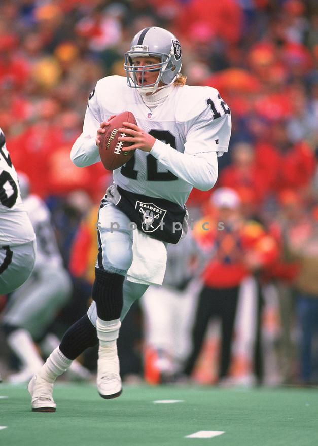 Oakland Raiders Todd Marinovich (12) during a game from his 1993 season with the Oakland Raiders. Todd Marinovich played for 2 season all with the Oakland Raiders.(SportPics)