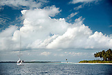 INDONESIA, Mentawai Islands, a sailboat anchored off of a small island in the Indian Ocean
