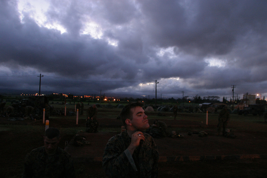 As a clouded-shrouded sun rises over the tent encampment created by the Marines for their two-day stay at the Army's Schofield Barracks, Cpl. Scott Kotecki runs an electric razor over his square jaw. A daily shave which insures a clean gas-mask seal as well as cleanliness and uniformity is the rule for the Marines.<br />