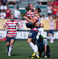 Abby Wambach (14) of the USWNT celebrates her goal with Alex Morgan (13) and other teammates during a friendly match at Sahlen's Stadium in Rochester, NY.  The USWNT defeated Costa Rica, 8-0.