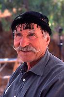 Greece. Western Crete. Cretan man in traditional headgear.MODEL RELEASED.
