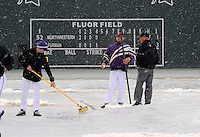 Players, coaches and members of the Fluor Field grounds crew clear snow from the playing field after a game between the Furman Paladins and Northwestern Wildcats was stopped after five innings due to heavy snow on Saturday, February 16, 2013, in Greenville, South Carolina. After a 90-minute delay the game was cancelled. (Tom Priddy/Four Seam Images)