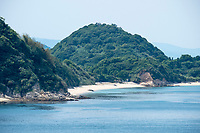 Dotted with small islands, Kanmon Strait is the narrow body of water between the main islands of Honshu and Kyushu, Japan.