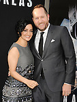 HOLLYWOOD, CA - MAY 26: Actress Archie Panjabi (L) and producer Beau Flynn arrive at the 'San Andreas' - Los Angeles Premiere at TCL Chinese Theatre IMAX on May 26, 2015 in Hollywood, California.