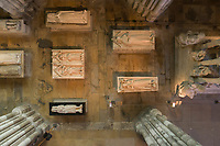 Royal tombs seen from above, with effigies of (right) Louis de France, d. 1260, Philippe de France, d. 1235, and (left) Blanche de France, d. 1320, Louis and Philippe, and Charles I of Anjou, king of Sicily, d. 1285, in the Basilique Saint-Denis, Paris, France. The basilica is a large medieval 12th century Gothic abbey church and burial site of French kings from 10th - 18th centuries. Picture by Manuel Cohen