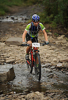 NWA Democrat-Gazette/ANDY SHUPE<br /> Aaron Rota of Fort Smith rides across Lee Creek Saturday, Sept. 19, 2015, during the Northwest Arkansas Mountain Bike Championships at Devil's Den State park.