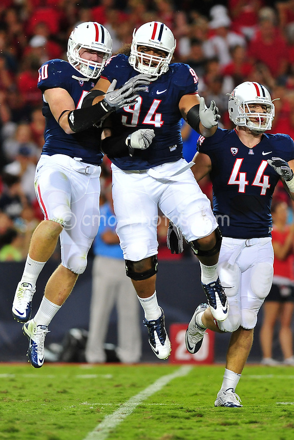 Sept 11, 2010; Tucson, AZ, USA; Arizona Wildcats linebacker Trevor Erno (10) and defensive tackle Lolomana Mikaele (94) celebrate a defensive stop in the 1st quarter of a game against the Citadel Bulldogs at Arizona Stadium.