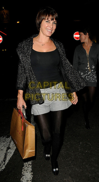 SADIE FROST & HOLLY DAVIDSON .At the PRPS Heart Start Launch Party, Start Boutique, London, England, UK, .3rd September 2009..full length black sparkly jacket top shorts tights grey gray shoes peep toe bag sweater dress jumper sisters siblings family .CAP/CAN.©Can Nguyen/Capital Pictures