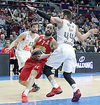 Real Madrid's Sergio LLull (l) and Jeffery Taylor (r) and Olympimpiacos Piraeus' Vassilis Spanoulis during Euroleague match. January 28,2016. (ALTERPHOTOS/Acero)