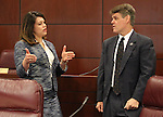 Nevada Assembly members Teresa Benitez Thompson, D-Reno, and Chris Edwards, R-Las Vegas, talk at the Legislative Building in Carson City, Nev., on Wednesday, May 20, 2015.<br /> Photo by Cathleen Allison