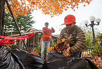 NWA Democrat-Gazette/BEN GOFF @NWABENGOFF<br /> Jackson Suggs (left) of Lewisville, Texas, and Nash Courtney, 11, of Rogers rake up leaves Saturday, Nov. 3, 2018, at Nicole's House in Rogers. The two families were volunteering to do fall yardwork at the transitional living facility for women recovering from drug and alcohol addiction.
