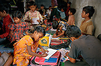 Children during a 2-hour school organized by Phulki. All of them work in the Mohammadpur rice market in Dhaka.