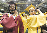 The Gazette. Classmates Kamau Agyeman, left and Jenae Gross, both 18 and of Upper Marlboro turn their respective tassels to their right symbolizing that they have graduated at the end of the Frederick Douglass High School graduation ceremony held at Show Place Arena in Upper Marlboro on Tuesday morning.